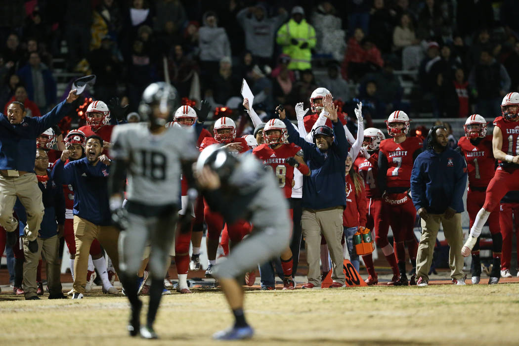Liberty celebrates a missed field goal by Bishop Gorman Dylan Hamika (43) in overtime of the fo ...