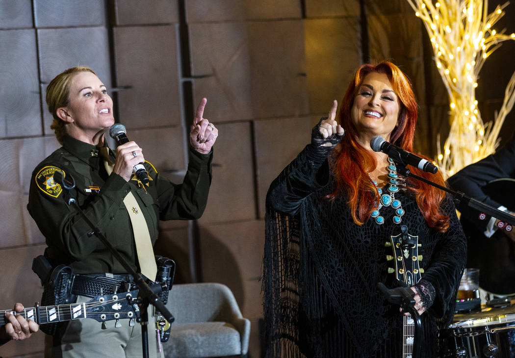 Metropolitan Police Department Captain Kelly McMahill, left, performs with singer-songwriter Wy ...