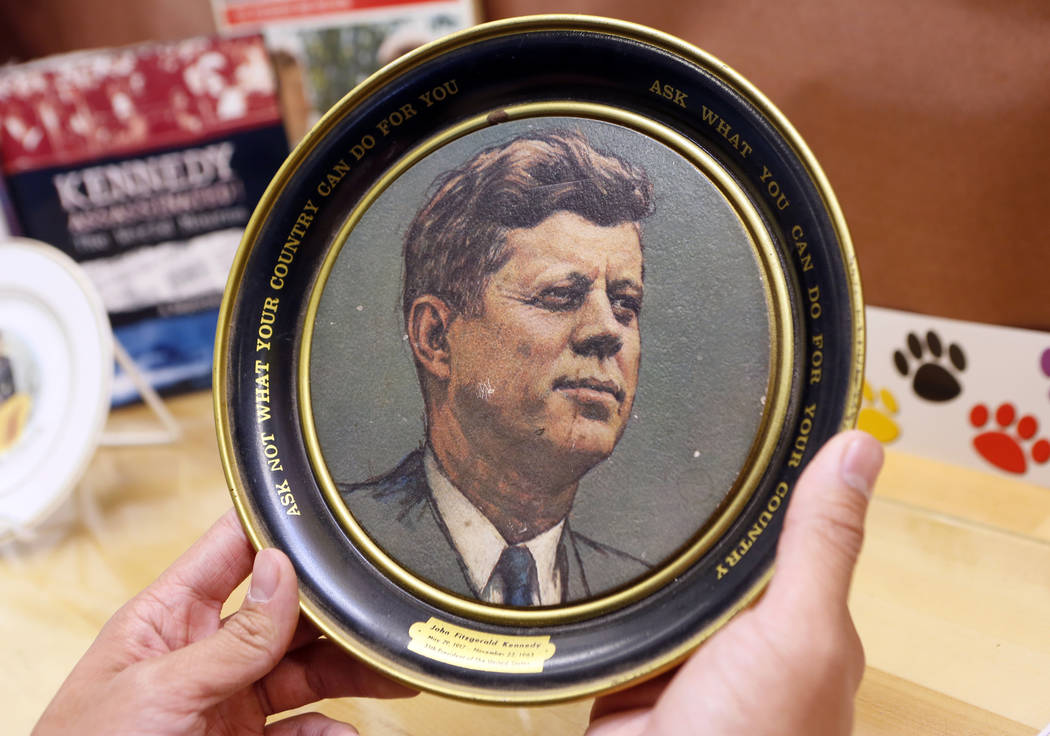 """A vintage plate with U.S. President John F. Kennedy's inaugural address quote: """"Ask not wh ..."""