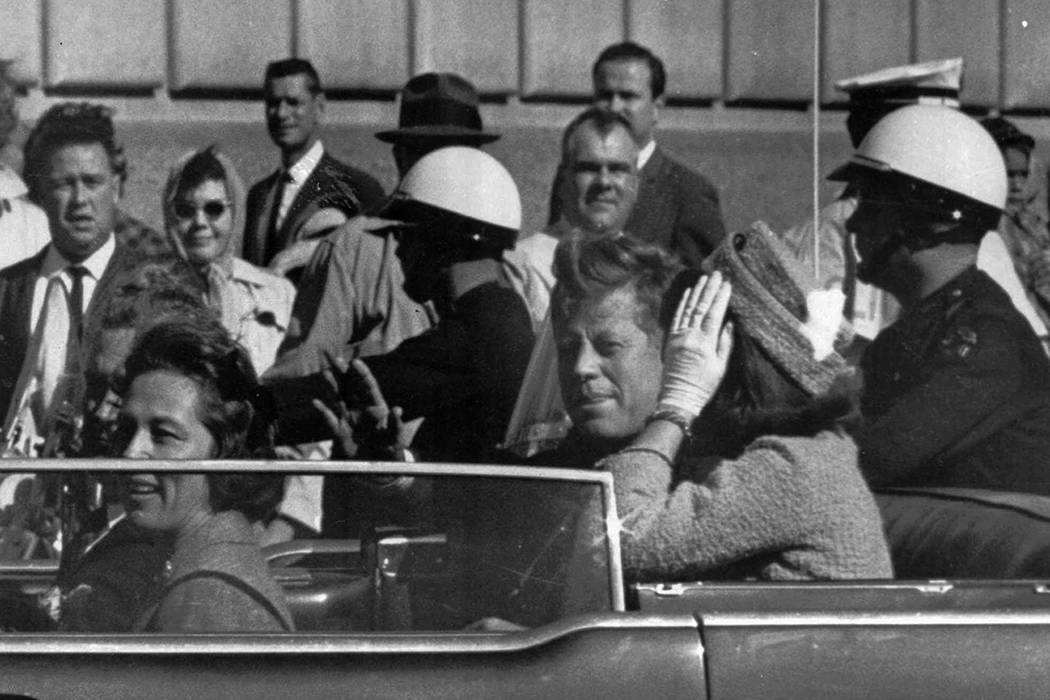 In this Nov. 22, 1963 file photo, President John F. Kennedy rides in a motorcade with his wife ...