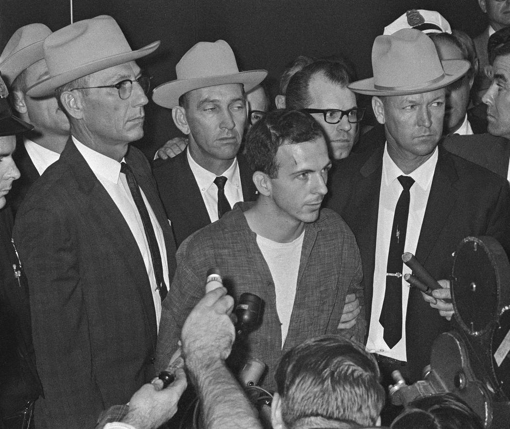 Lee Harvey Oswald is shown early Nov. 23, 1963, as he stood before newsmen in a Dallas police s ...