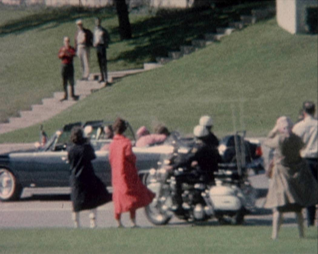 First Lady Jacqueline Kennedy cradles her husband President John F. Kennedy seconds after he wa ...