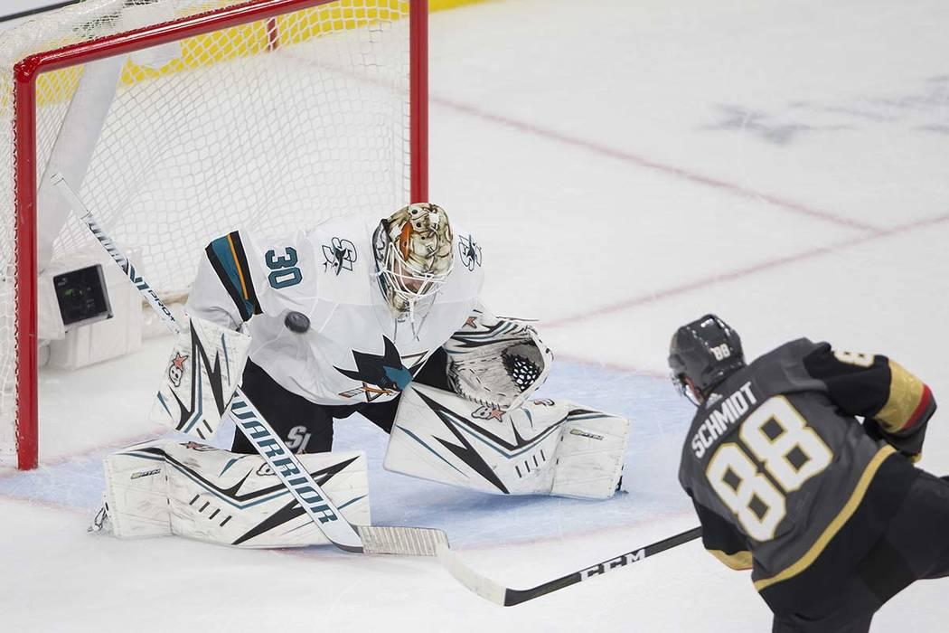 Vegas Golden Knights defenseman Nate Schmidt (88) shoots on San Jose Sharks goaltender Aaron De ...