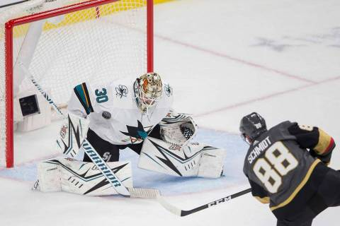 Vegas Golden Knights defenseman Nate Schmidt (88) shoots on San Jose Sharks goaltender Aaron De ...