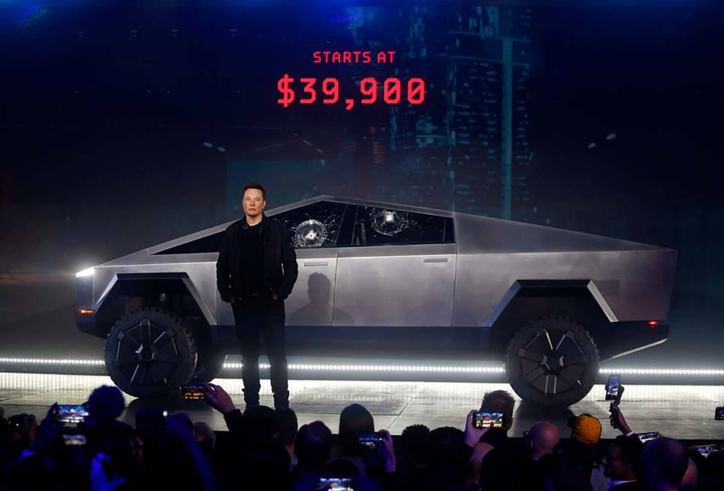 Tesla CEO Elon Musk introduces the Cybertruck at Tesla's design studio Thursday, Nov. 21, 2019, ...