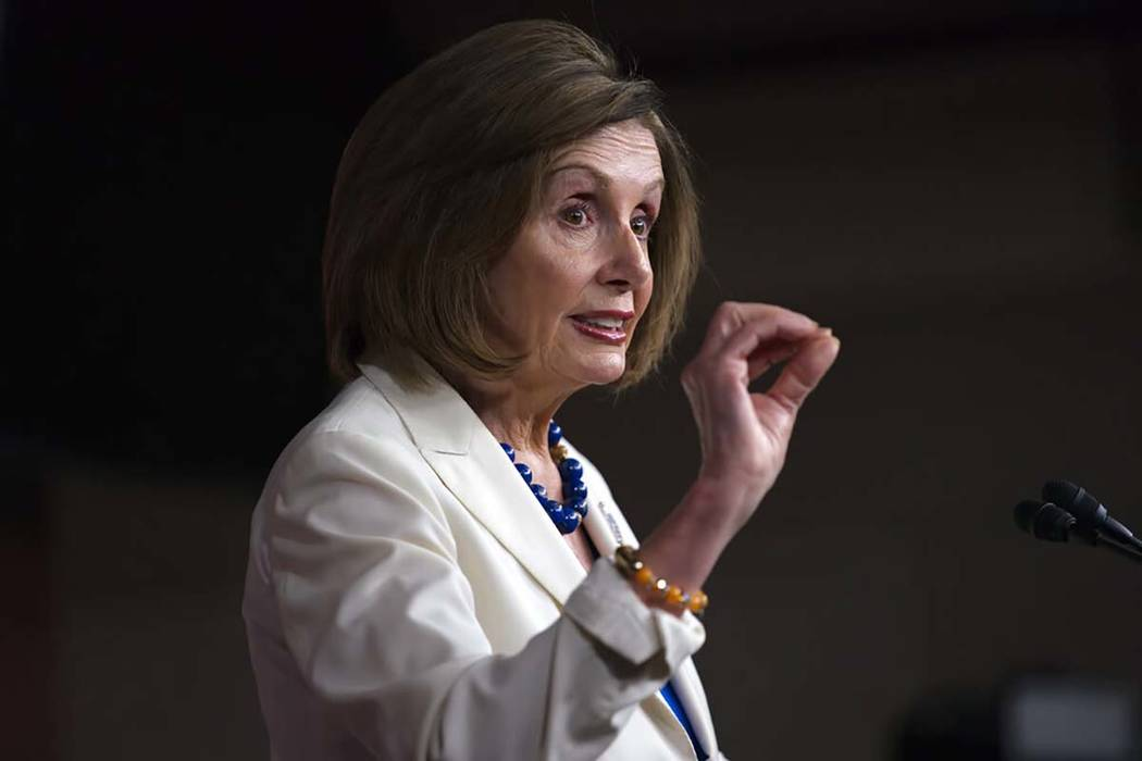Speaker of the House Nancy Pelosi, D-Calif., talks to reporters as the House Intelligence Commi ...