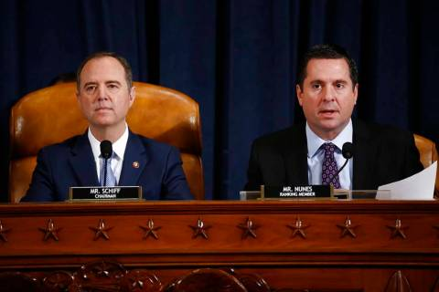 Rep. Devin Nunes, R-Calif., right, the ranking member of the House Intelligence Committee, join ...