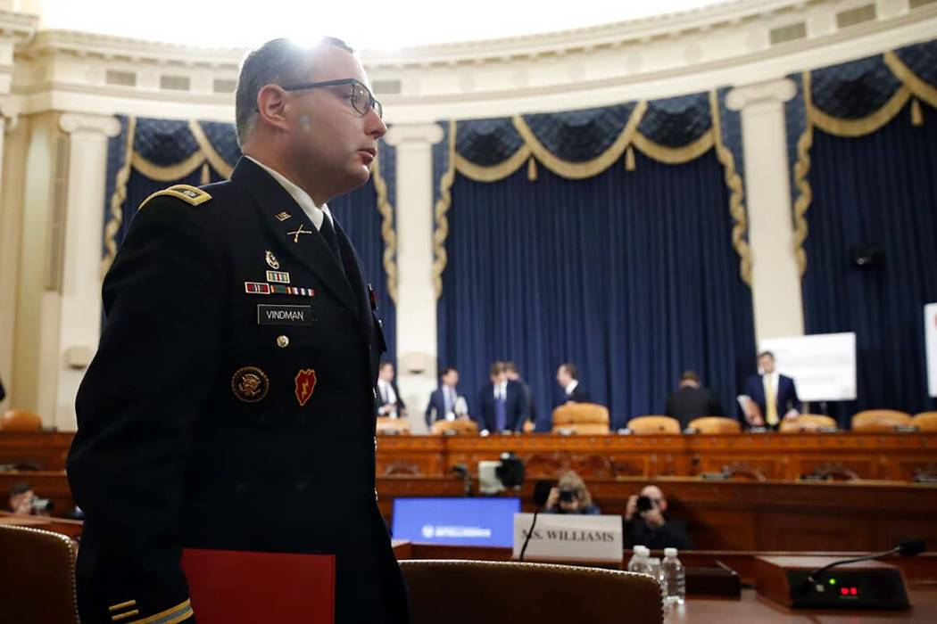 National Security Council aide Lt. Col. Alexander Vindman departs after testifying before the H ...