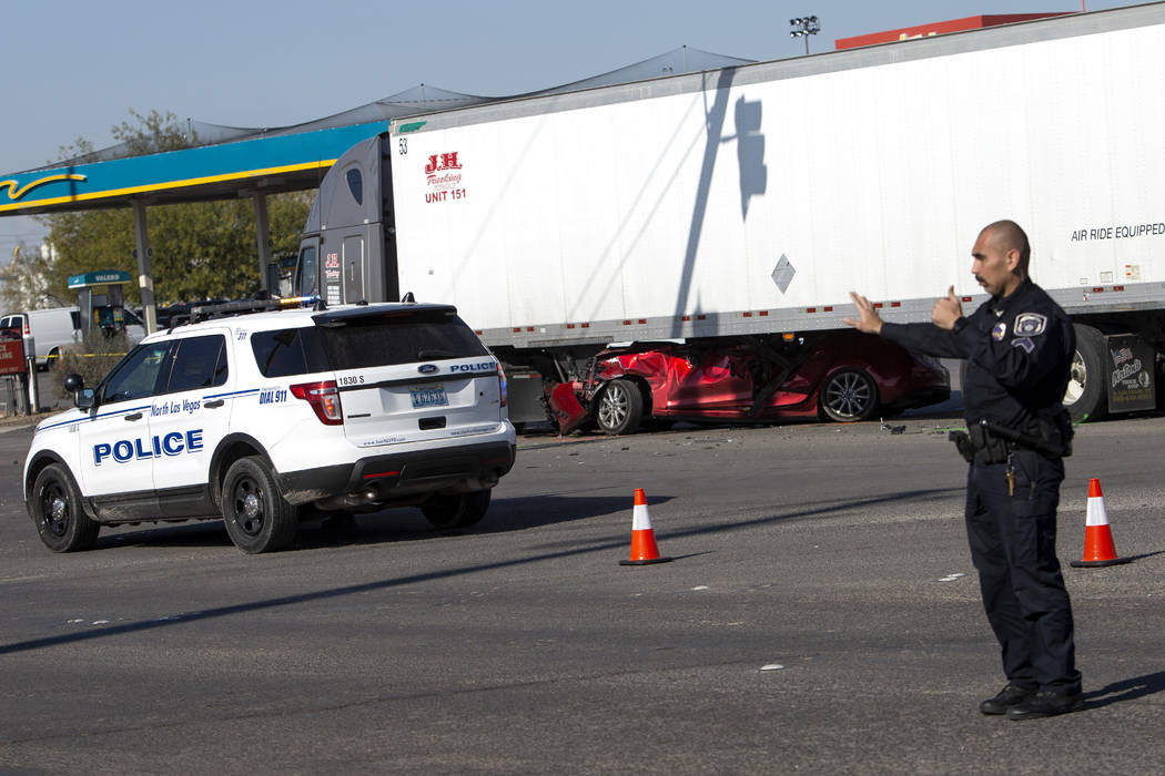 A North Las Vegas police officer commands traffic past a fatal crash that occurred at East Chey ...