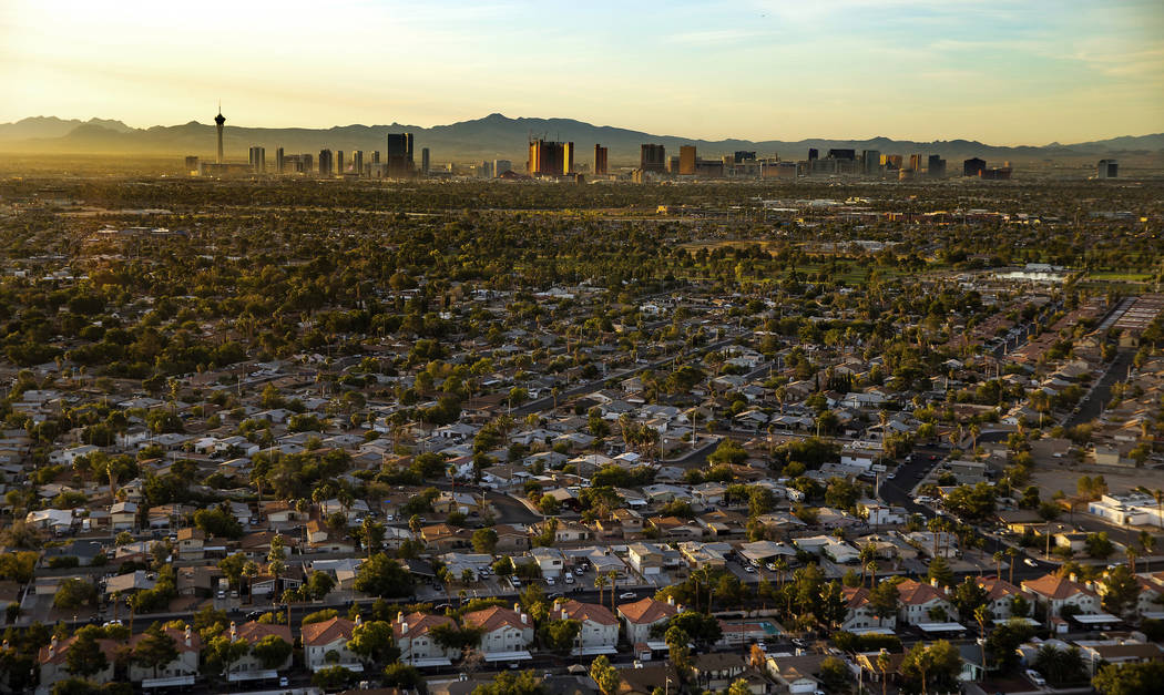 The sun rises on the city looking to the Strip from the west end on Wednesday, Oct. 16, 2019, i ...