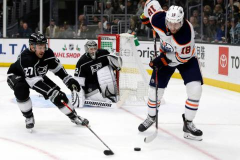 Edmonton Oilers left wing James Neal, right, controls the puck near Los Angeles Kings defensema ...