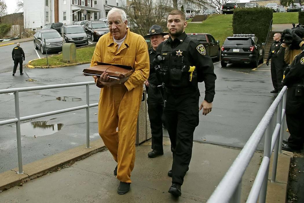 Former Penn State University assistant football coach Jerry Sandusky, left, arrives at the Cent ...