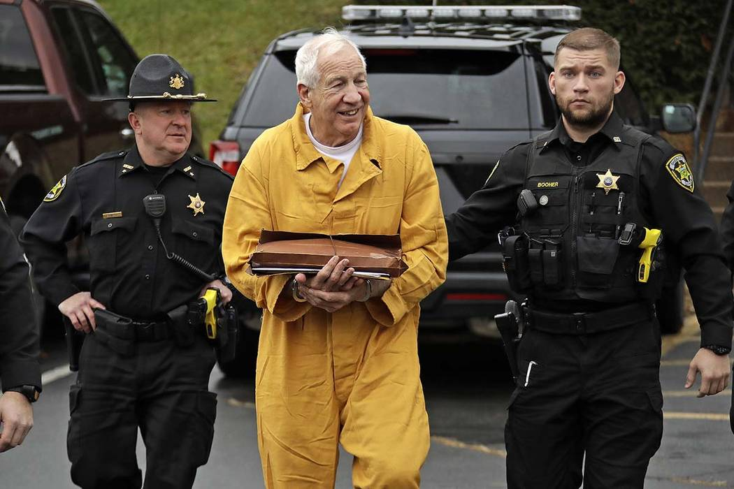 Former Penn State University assistant football coach Jerry Sandusky, center, arrives at the Ce ...
