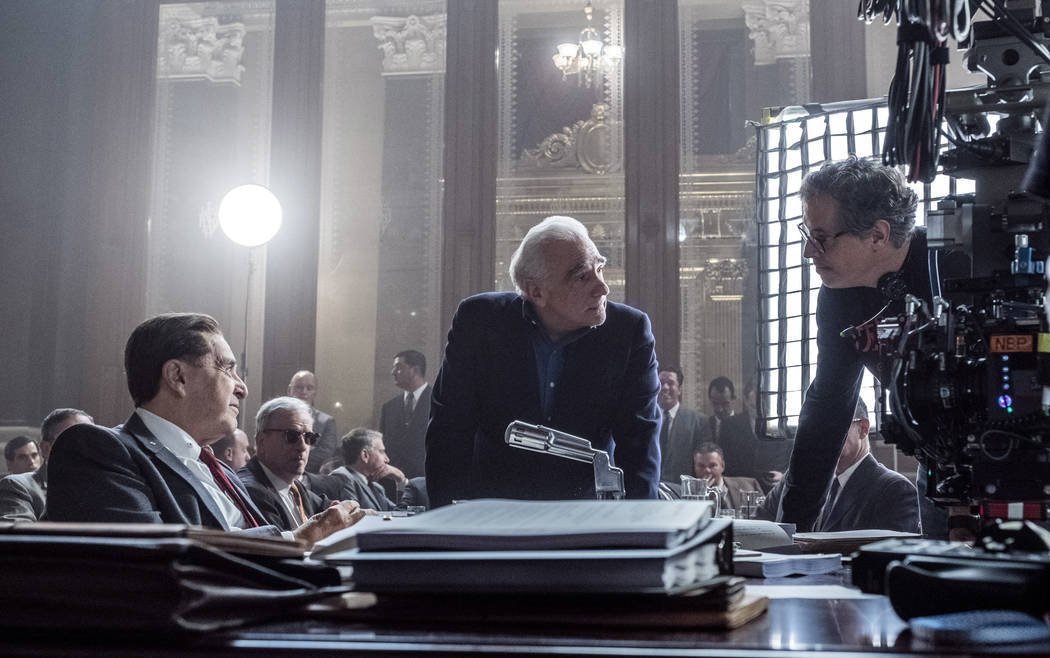 Martin Scorsese with Al Pacino, left, and cinematographer Rodrigo Prieto, right, on the set of ...