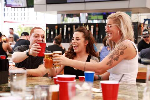 Scott Trimble, from left, Carissa Colligas and Jordan Rogers enjoy drinks at Beer Park at Paris ...