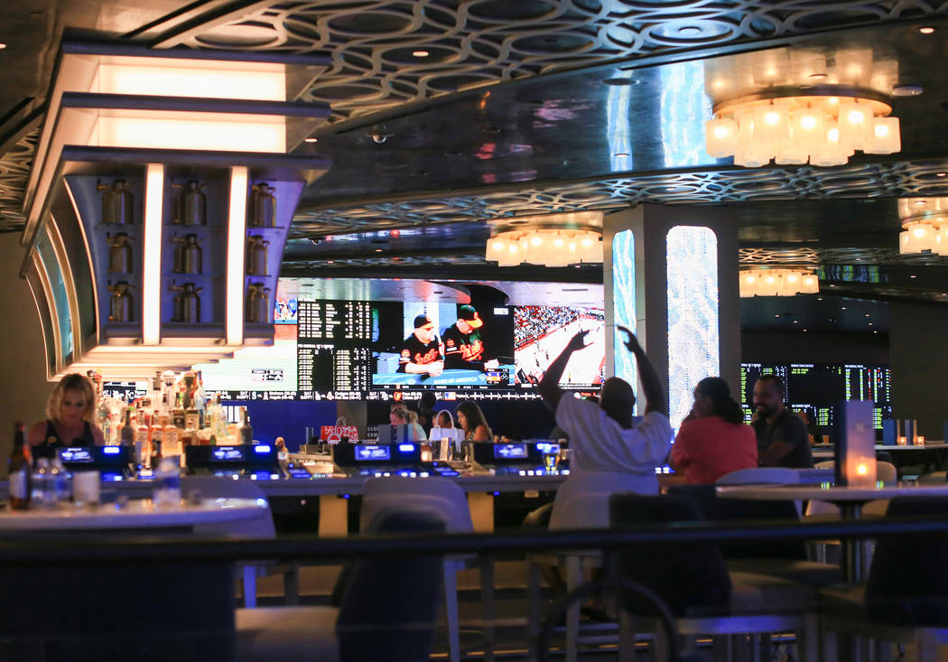A newly renovated sports book can be seen from BLVD & MAIN Taphouse at The STRAT hotel-casino i ...