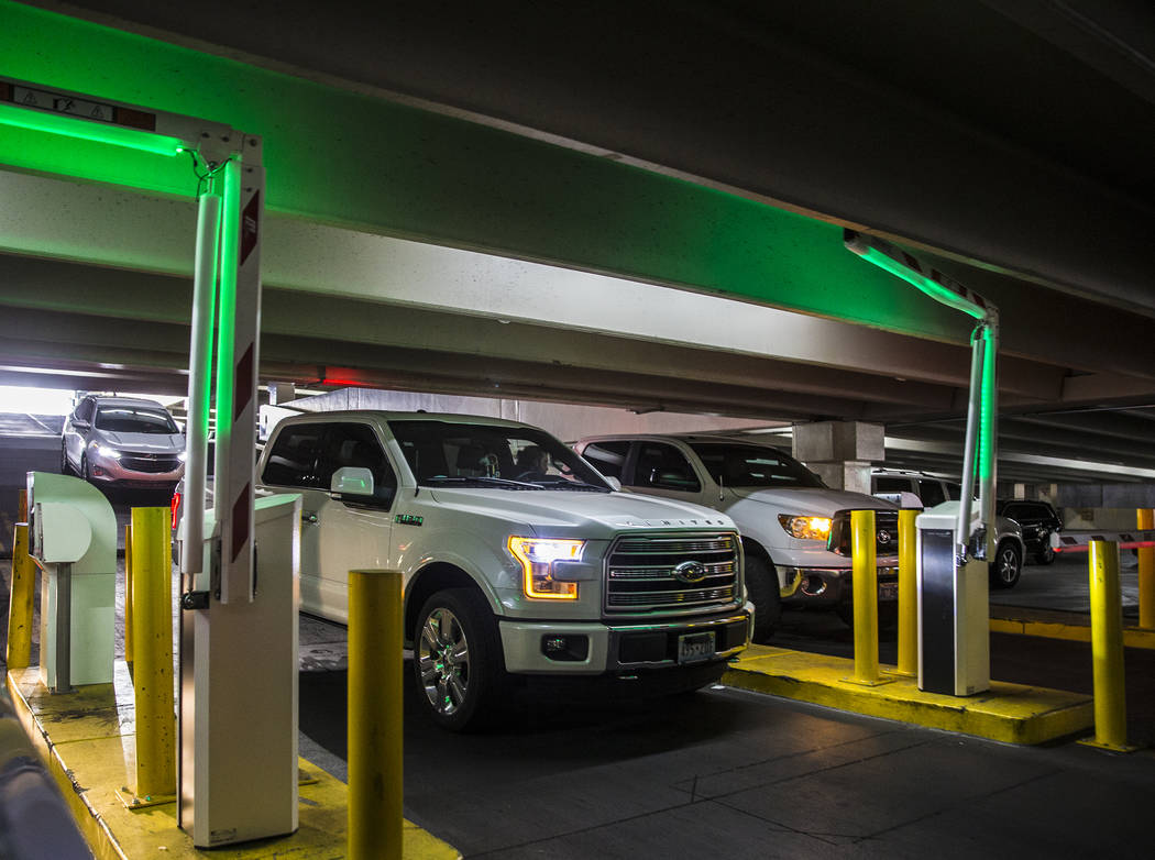 Guests pay for parking at the Caesars Palace garage on Thursday, May 16, 2019, in Las Vegas. (L ...