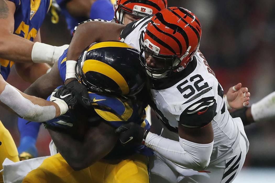 Cincinnati Bengals middle linebacker Preston Brown (52) tackles Los Angeles Rams running back D ...