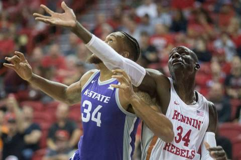 UNLV Rebels forward Cheikh Mbacke Diong (34) fights for a rebound with Kansas State Wildcats fo ...