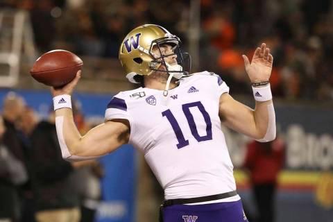 Washington quarterback Jacob Eason (10) warms up prior to the start of an NCAA college football ...