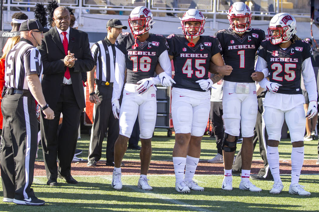 Former UNLV Rebels quarterback Randall Cunningham, center left, is ready to take the field with ...