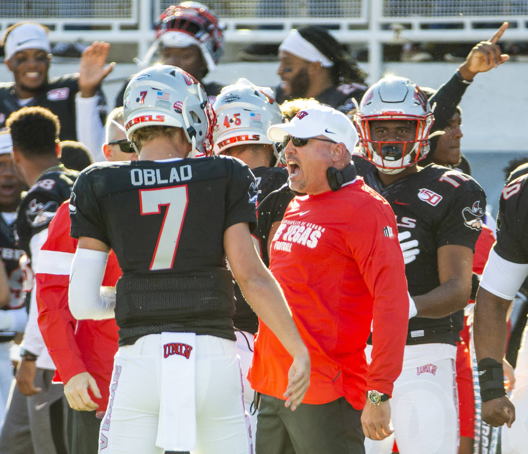 UNLV Rebels quarterback Kenyon Oblad (7) is congratulated on another touchdown by UNLV Rebels h ...