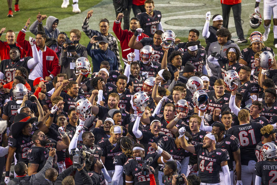 The UNLV Rebels come together in the end zone to celebrate their win over the San Jose State Sp ...