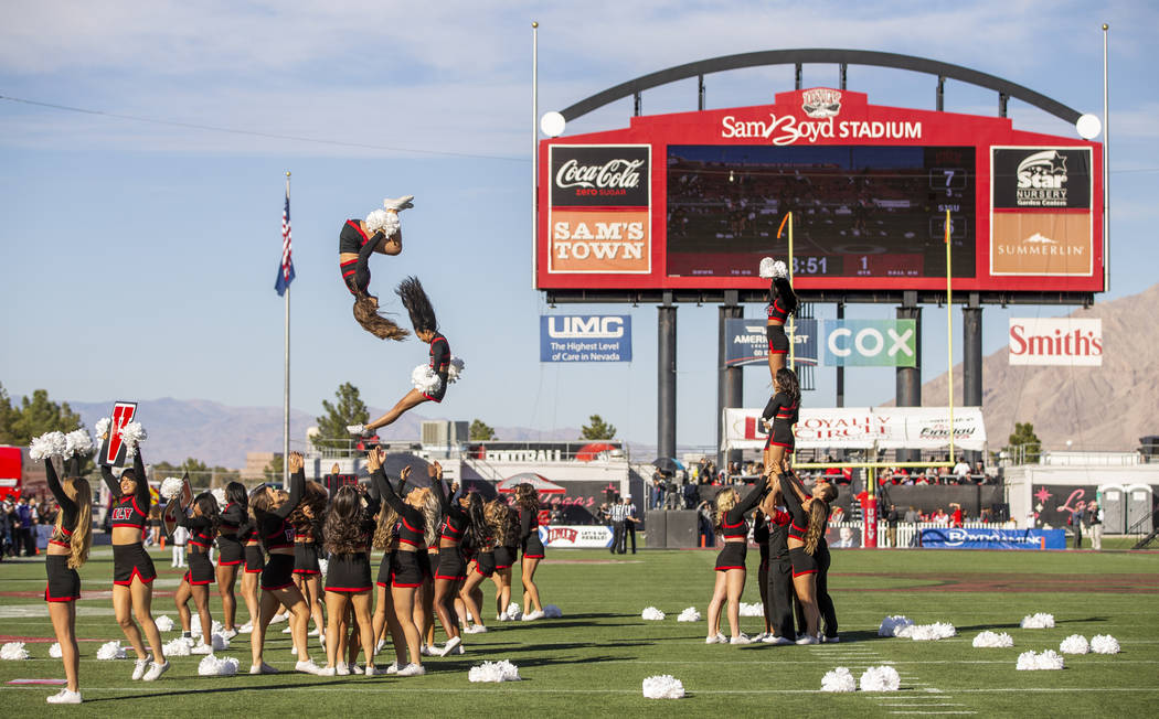 The UNLV cheerleaders perform for the crowd while the team battles the San Jose State Spartans ...