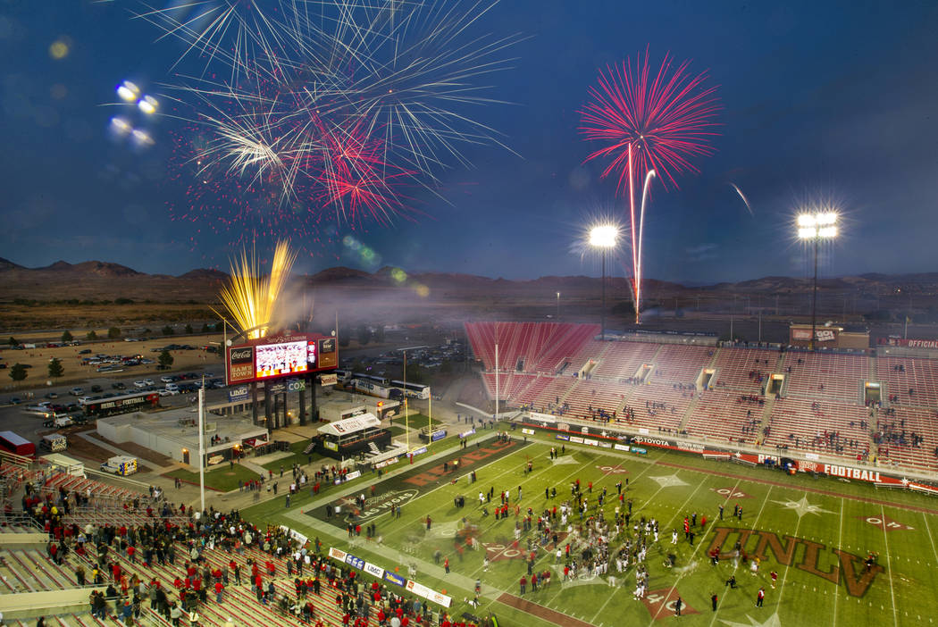 Fireworks erupt above Sam Boyd Stadium following the final game there as the UNLV Rebels defeat ...