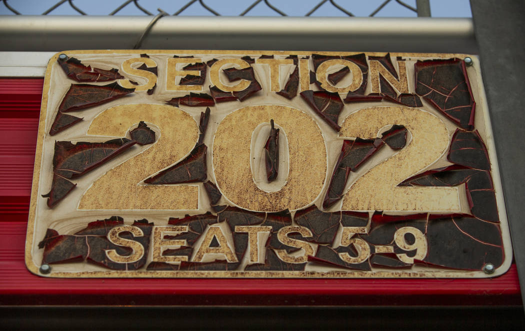 Paint peels on a sign at Sam Boyd Stadium as the UNLV Rebels continue to battle with the San J ...