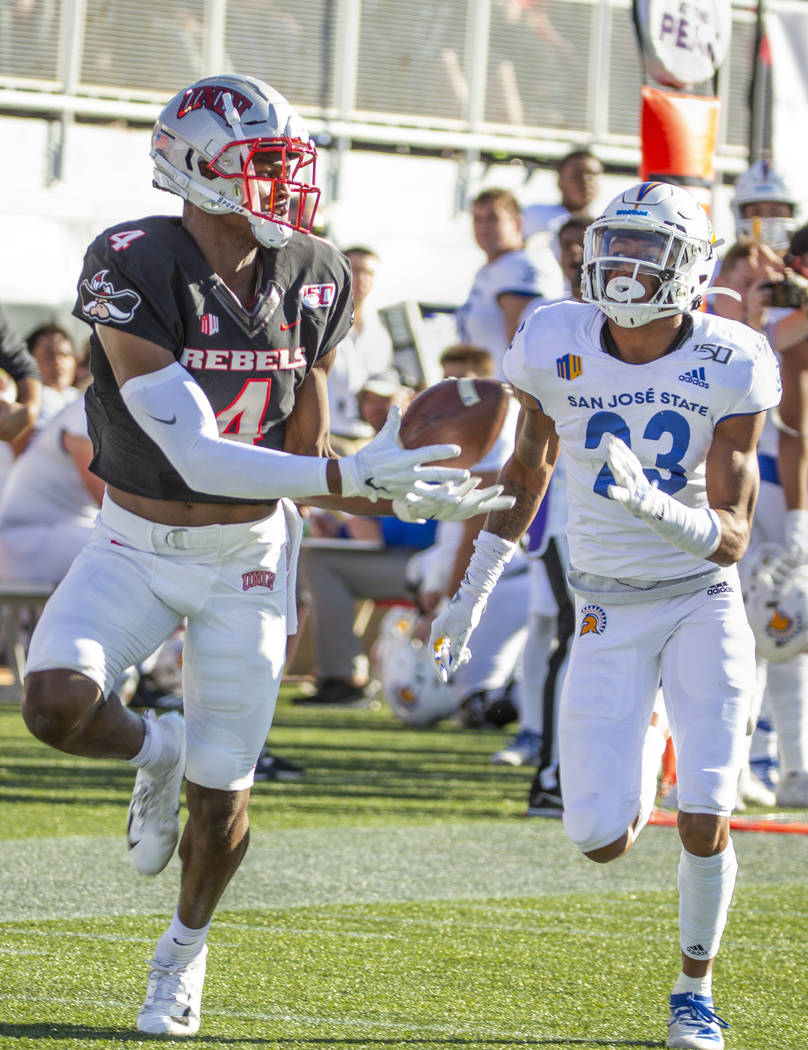 UNLV Rebels wide receiver Randal Grimes (4, left) hauls in a bobbled pass for a touchdown over ...