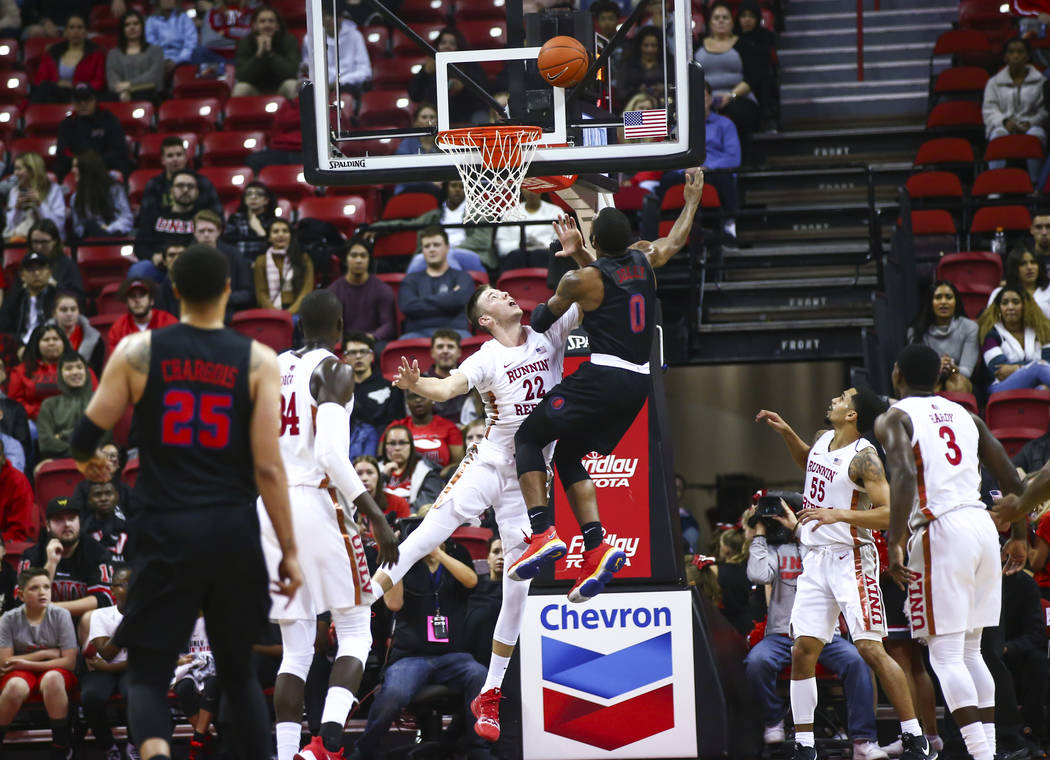 Southern Methodist's Tyson Jolly (0) goes to the basket against UNLV's Vitaliy Shibel (22) duri ...