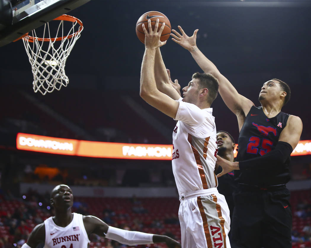 UNLV's Vitaliy Shibel (22) goes to the basket past Southern Methodist's Ethan Chargois (25) dur ...