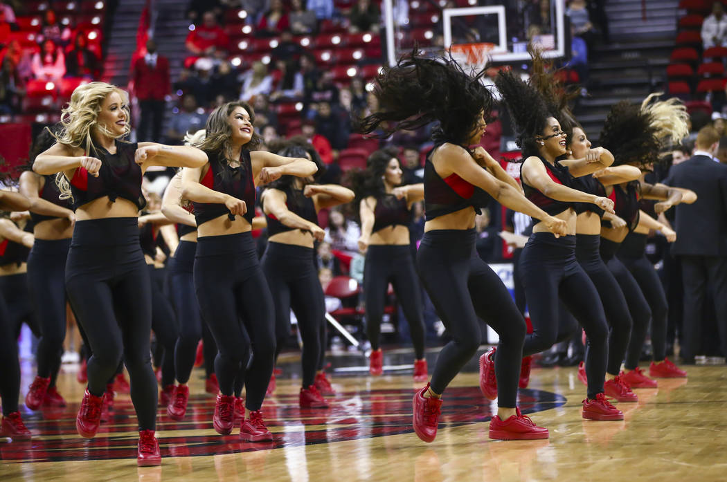 The Rebel Girls perform during the first half of a basketball game at the Thomas & Mack Center ...
