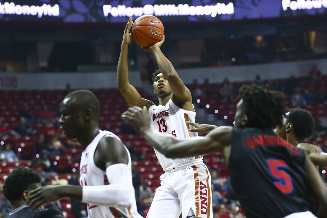 UNLV's Bryce Hamilton (13) shoots against Southern Methodist during the first half of a basketb ...