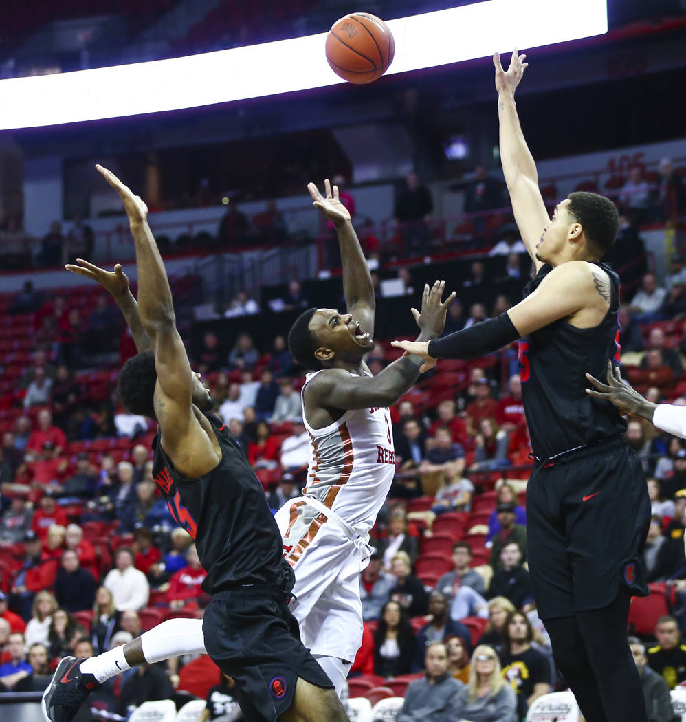 UNLV's Amauri Hardy (3) loses possession of the ball between Southern Methodist's Isiaha Mike, ...