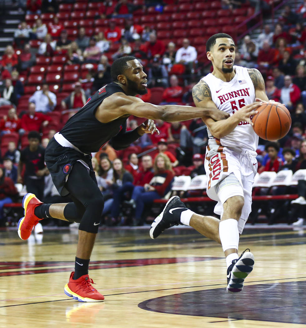 Southern Methodist's Tyson Jolly, left, fouls UNLV's Elijah Mitrou-Long (55) during the second ...