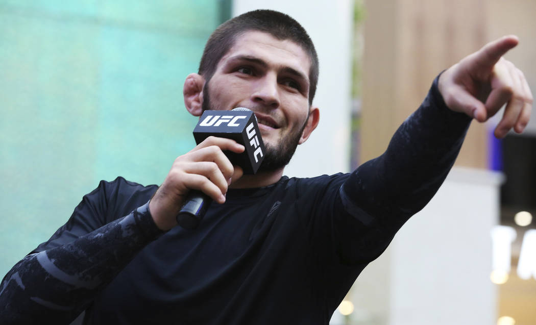 Russian UFC fighter Khabib Nurmagomedov gestures to the crowd during an open training session a ...
