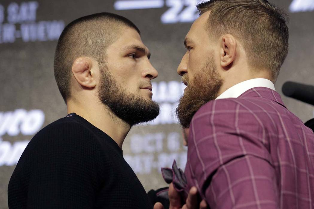 Conor McGregor, right, and Khabib Nurmagomedov pose for pictures during a news conference in Ne ...