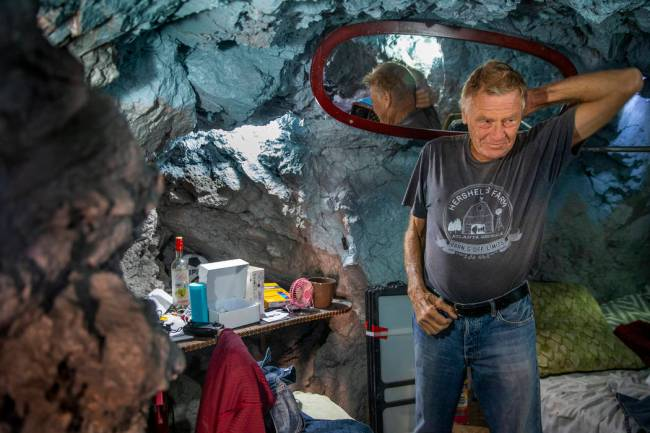 Richard Roman inside his bedroom area about living in a former mine in the hillside above the R ...