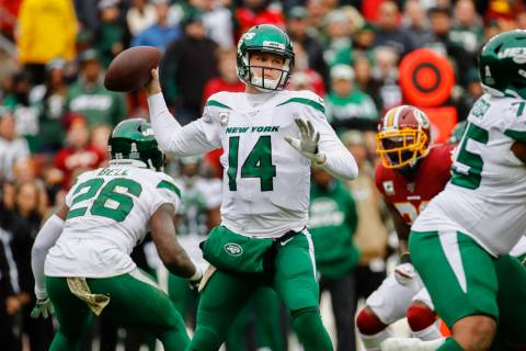New York Jets quarterback Sam Darnold (14) looks to pass the ball in the first half of an NFL f ...