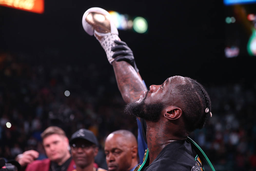 Referee Kenny Bayless raises the hand of Deontay Wilder after knocking out Luis Ortiz during th ...