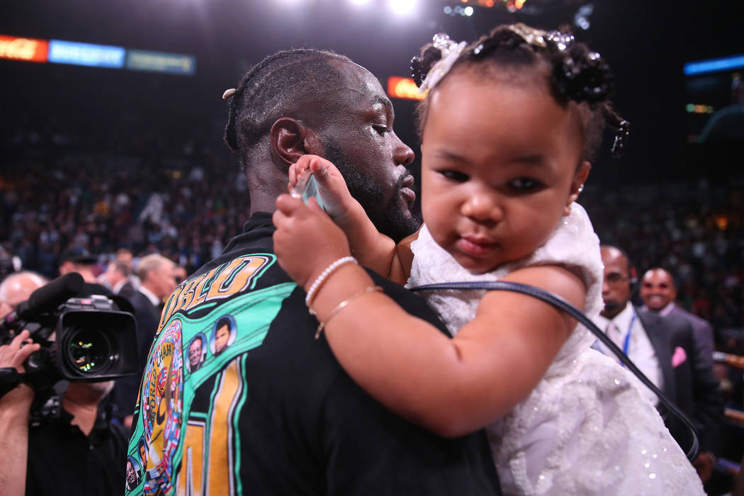 Deontay Wilder holds his 1-year-old daughter Kaorii, 1, after his knockout win against Luis Or ...