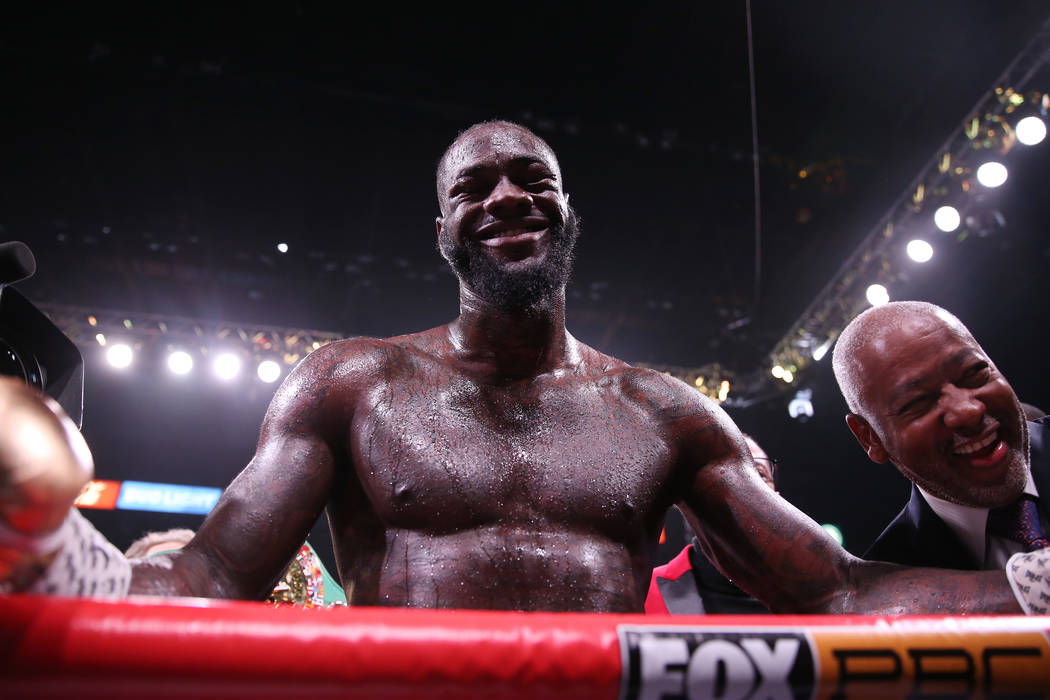 Deontay Wilder celebrates after his knockout win against Luis Ortiz in the seventh round of the ...