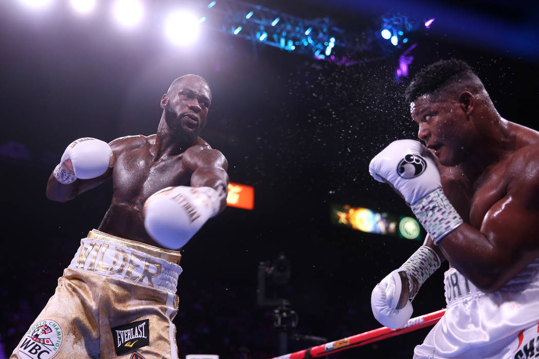 during the X round of the WBC heavyweight title bout at the MGM Grand Garden Arena in Las Vegas ...
