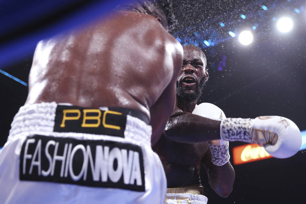 Deontay Wilder, right, knocks out Luis Ortiz during the seventh round of the WBC heavyweight ti ...