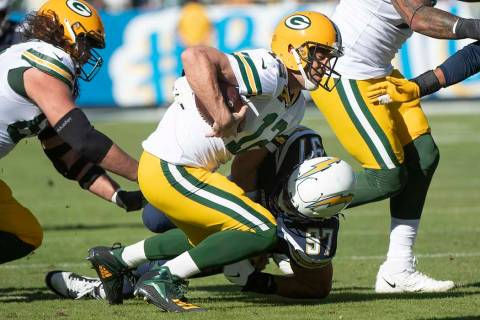 Los Angeles Chargers defensive end Joey Bosa, back, sacks Green Bay Packers quarterback Aaron R ...