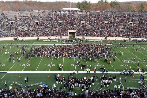 Demonstrators stage a climate change protest at the Yale Bowl delaying the start of the second ...