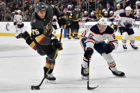 Vegas Golden Knights right wing Ryan Reaves (75) shoots next to Edmonton Oilers defenseman Cale ...