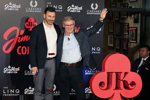 TV host Jimmy Kimmel, left, and Tony Rodio, right, CEO of Caesars Entertainment, wave to the cr ...